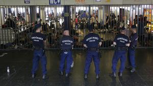 Hungarian police guard an entrance to the Keleti Railway Station in Budapest (AP)
