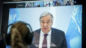 Antonio Guterres, UN Secretary-General displayed on a screen at the Environment Ministry as he delivers his speech at the Petersberg Climate Dialogue, in Berlin, Germany, Tuesday, April 28, 2020. Due to the coronavirus crisis, the conference will only be held digitally. (Michael Kappeler/Pool via AP)