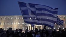 Demonstrators in front of the parliament in Athens support the new government's push for a better deal on debt. (AP)