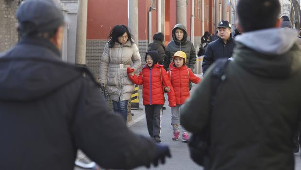Children are escorted from the site of the attack (AP Photo/Ng Han Guan)