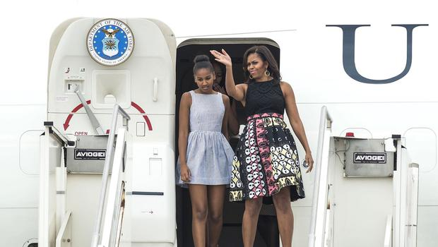 US First Lady Michelle Obama and her daughter Sasha arrive in Milan. (AP)