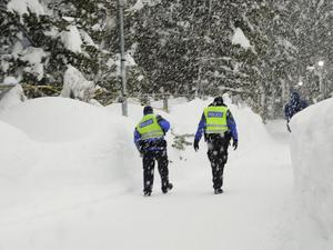 Police officers battling the elements in Davos (Markus Schreiber/AP)