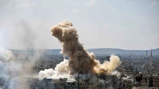 Syrian government air strikes and shelling hit in Hajar al-Aswad in northern Damascus (SANA/AP)