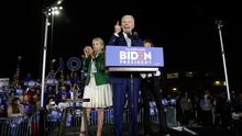 RUNNING MATE: Joe Biden at a campaign rally in LA last week with his wife Jill leading the applause. Photo: Chris Carlson/AP