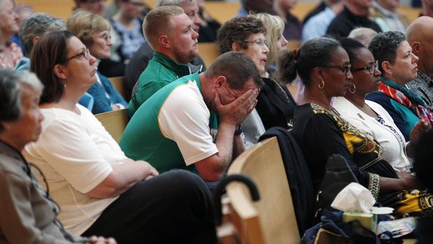 A man holds his head during a memorial service for the six students at the Cathedral of Christ the Light in Oakland, California (AP)