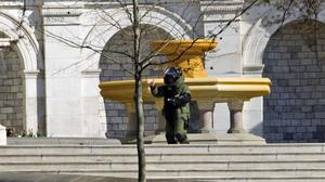 A bomb squad member searches the US Capitol building in Washington DC (AP)