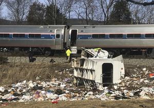 Emergency personnel work at the scene of a train crash in Virginia (Zack Wajsgrasu/The Daily Progress via AP)