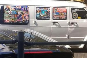 The van's windows were covered with stickers (Courtesy of Lesley Abravanel via AP)