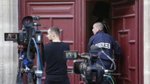 A French police officer enters the apartment rented by Kim Kardashian in Paris (AP)