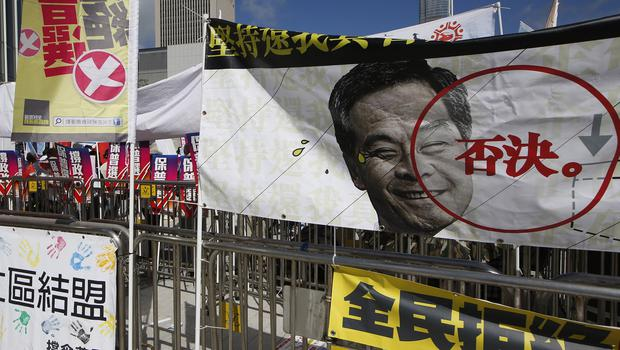 "A banner depicting picture of Hong Kong chief executive Leung Chun-ying with the word ""Reject"" is displayed outside the Legislative Council (AP)"