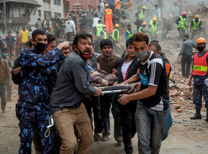 AFTERMATH: Rescue workers carry a victim on a stretcher after the collapse of Dharahara Tower in Kathmandu. Photo: Omar Havana/Getty