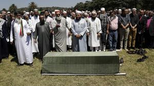 Friends and family with the coffin carrying the body of Ahmed Kathrada. (AP/Themba Hadebe)