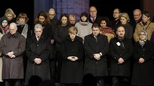 German Chancellor Angela Merkel, centre, attends a vigil organised by the German Muslim Council. (AP)