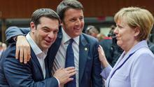 Italian prime minister Matteo Renzi, centre, speaks with Greek prime minister Alexis Tsipras and German chancellor Angela Merkel during a round table meeting at an EU summit in Brussels (AP)