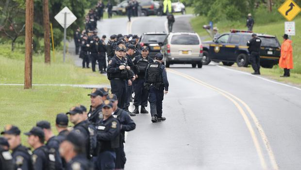 Police emerge from a wood during the search for two escapees from Clinton Correctional Facilityin New York state. (AP)
