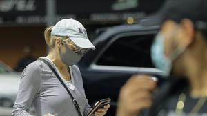 Pedestrians wear protective masks while crossing Second Avenue in New York during the coronavirus pandemic (Frank Franklin II/AP)
