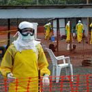 Health workers preparing an isolation camp in Guinea Credit: Reuters