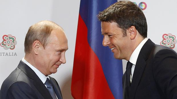 Italian Premier Matteo Renzi, right, shakes hands with Vladimir Putin. (AP)