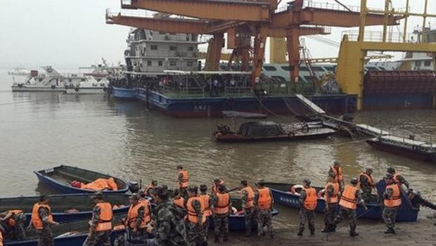 Rescue workers prepare to head out on boats on the Yangtze River to search for missing passengers after a ship capsized in central China's Hubei province (Chinatopix/AP)