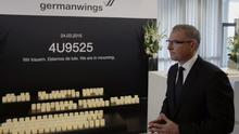Lufthansa chief Carsten Spohr, pictured earlier this year walks by a memorial to the victims of the Germanwings plane crash (AP)