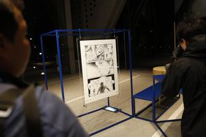 A poster by Naoki Urasawa, one of 20 posters officially selected for the Tokyo Olympics and Paralympics, on display at the Museum of Contemporary Art Tokyo (Jae C Hong/AP)