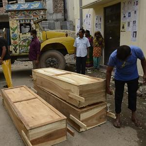 Workers off-load coffins at a morgue in Dhaka, Bangladesh (AP)