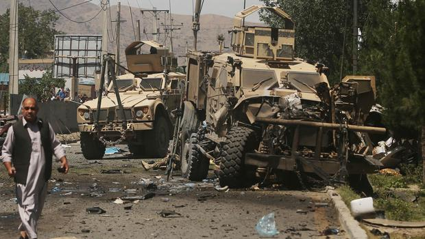 A destroyed armoured vehicle remains at the site of a blast targeting the Nato convoy in Kabul (AP)