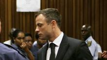Oscar Pistorius is led out of court in Pretoria, South Africa, after receiving a five-year prison sentence (AP)