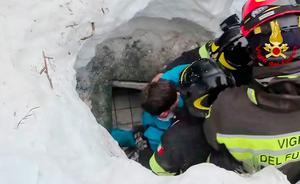 This frame from video shows Italian firefighters extracting a boy alive from under snow and debris of an hotel that was hit by an avalanche on Wednesday, in Rigopiano, central Italy, Friday, Jan. 20, 2017. (Italian Firefighters/ANSA via AP)