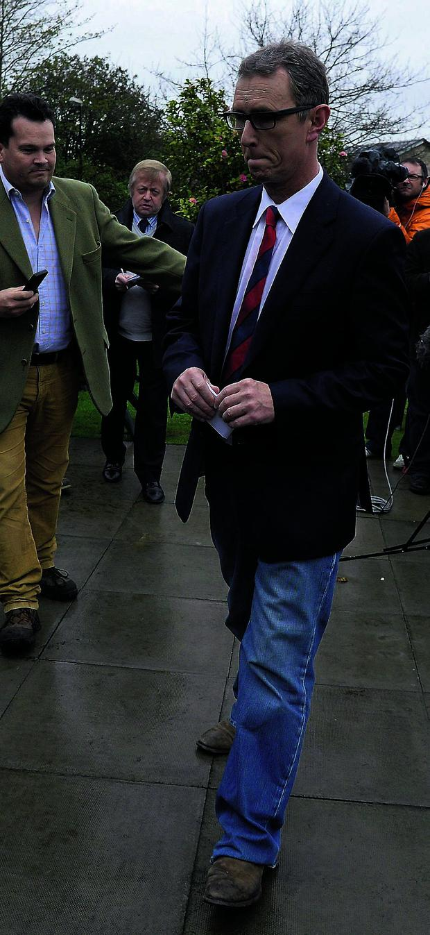 British Conservative MP and Deputy House of Commons Speaker Nigel Evans leaves after a news conference in Pendleton, northern England May 5, 2013.