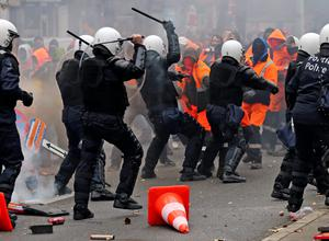 Riot police use their batons during clashes with demonstrators in central Brussel. Photo: Reuters