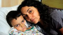 Ashya with his mother Naghemeh King. The parents of five-year-old English boy Ashya King, who were detained after taking him abroad for brain tumour treatment, say their son is now free of cancer