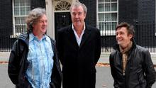 The BBC insisted it will stand by Top Gear presenter Jeremy Clarkson (C) after he was reprimanded by broadcasting regulator Ofcom for racial comments