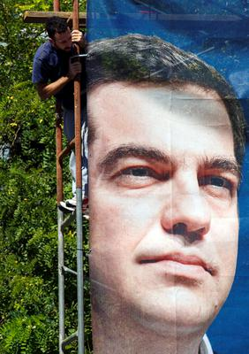 A poster depicting Syriza leader Alexis Tsipras, who has seen his party's 15-point polling lead evaporate in the run-up to Greece's third election in eight months.