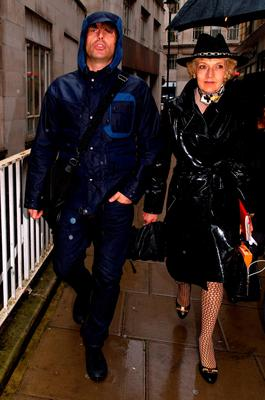 Liam Gallagher and solicitor Fiona Shackleton arrive at the Family Court in London yesterday