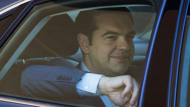 Greek Prime Minister Alexis Tsipras leaves the European Commission headquarters after a meeting with the European Commission, the International Monetary Fund (IMF) and the European Central Bank in Brussels yesterday
