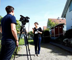 A TV crew records a report in front of the house in Wuerenlingen, Switzerland