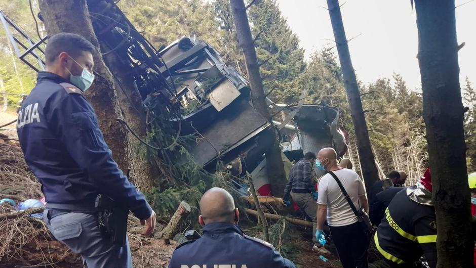 Rescuers work by the wreckage of a cable car after it crashed near the summit of the Stresa-Mottarone line in the Piedmont region of northern Italy last May. Photo: Italian Police via AP