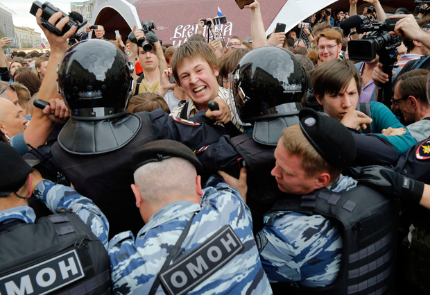 Protesters scuffle with police. Photo: AP