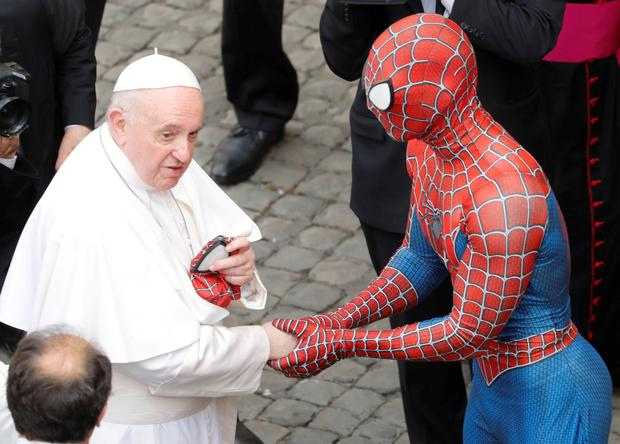 Pope Francis meets a man dressed as Spiderman after a general audience at the Vatican. Photo: REUTERS/Remo Casilli