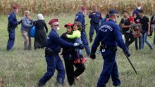 Hungarian police stopping refugees in Roszke, Hungary