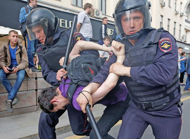 Riot police detain a protester during a demonstration in central Moscow yesterday. Photo: Reuters