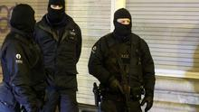 Policemen stand guard in Verviers, eastern Belgium, on January 15, 2015, after two men were reportedly killed during an anti-terrorist operation.