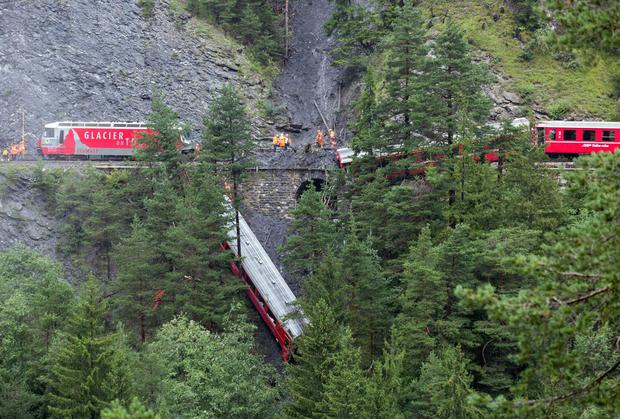 A passenger train traveling from St Moritz to Chur in eastern Switzerland has been derailed by a landslide, injuring nearly one dozen passengers, several of them seriously