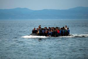Refugees and migrants arrive in a dinghy to the Greek island of Lesbos