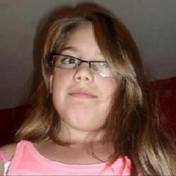A neighbour of Tia Sharp's grandmother has been charged with wasting police time (Metropolitan Police/PA)