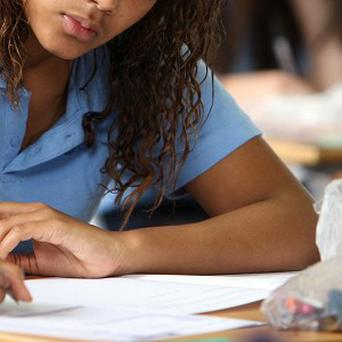 The AQA and Edexcel exam boards are accused of 'illegitmate grade manipulation', which they both deny