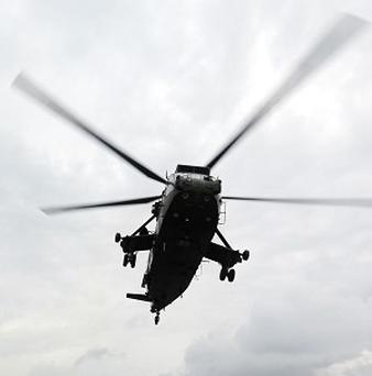 A Sea King helicopter airlifted a 10-year-old boy who had fallen 165ft down a snow-covered mountain