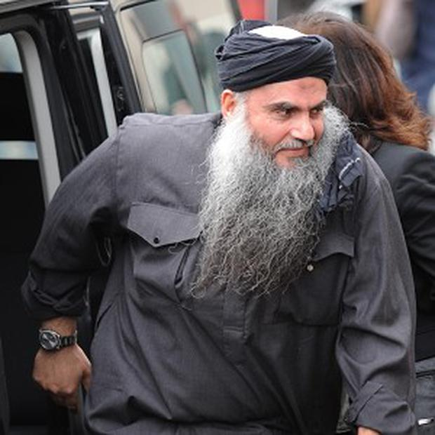 Protesters have been demonstrating outside the house where Abu Qatada's wife and five children live