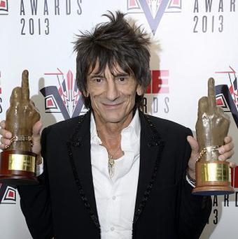 Ronnie Wood with the awards won by Rolling Stones for best music film and music moment of the year at the NME awards